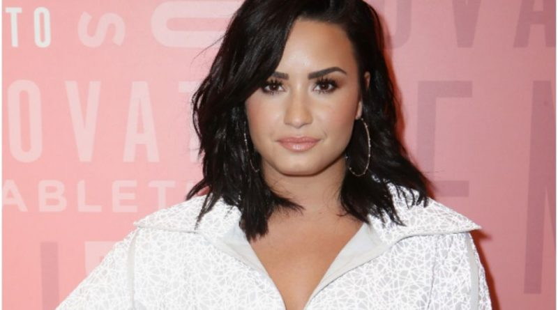Demi Lovato boasts that her breasts are natural with a selfie that shows her without underwear