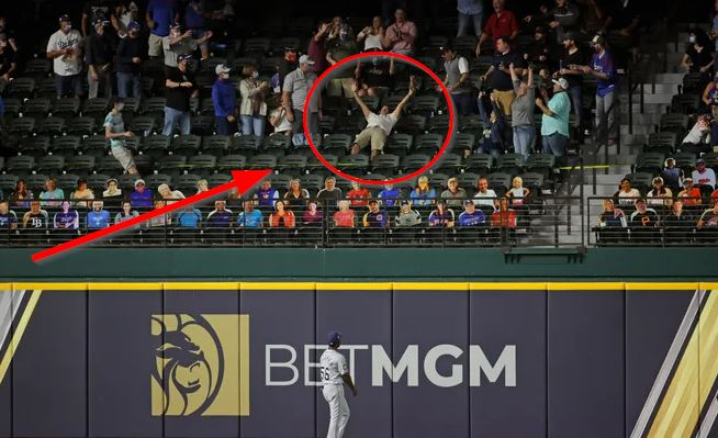 WATCH: Fan at World Series flings glove on field after catching Will Smith home run