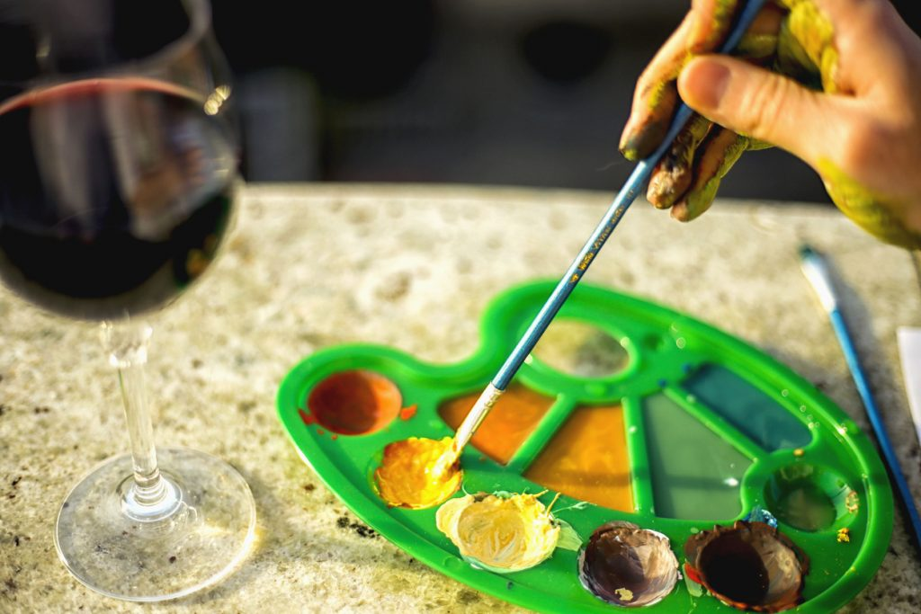 Color palette with glass of wine.