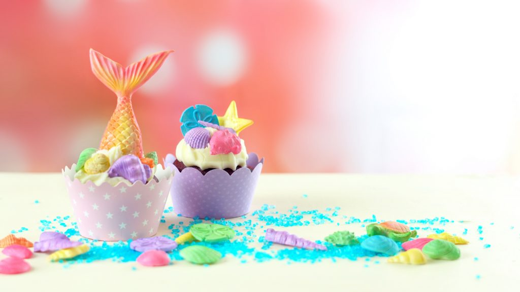 Mermaid theme cupcakes with colorful glitter tails, shells and sea creatures toppers for children's mermaid birthday Party
